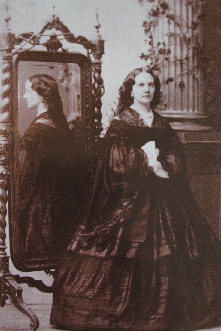 Young woman in mourning dress, c. 1865.