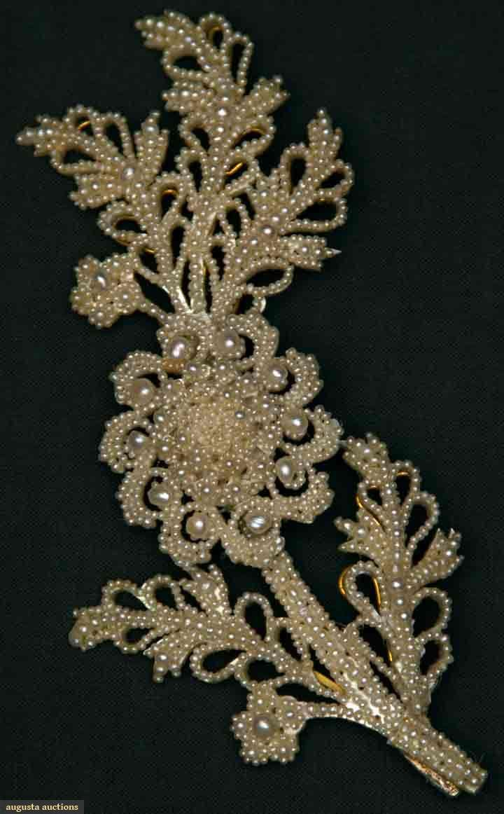 "Augusta Auctions, November 10, 2010 - St. Pauls - NYC, Lot 94: Large Seed Pearl Brooch, Mid 19th C Floral spray, pearls attached to M.O.P. backing, 6"" x 2.5"", excellent."