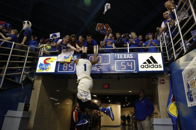 Kansas guard Wayne Selden jumps to slap hands with a row of Jayhawk fans after defeating Texas 85-54 on Saturday, Feb. 22, 2014 at Allen Fieldhouse. #KU