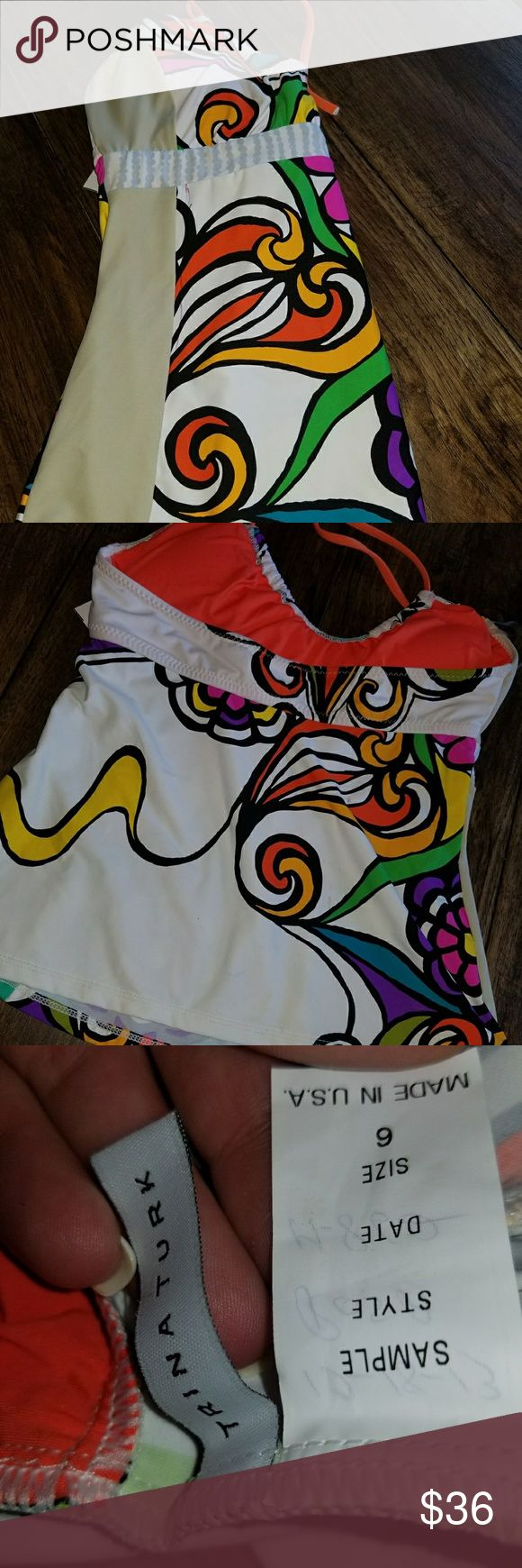 Trina Turk Aquarius tankini top. New With Tags.  Age of Aquarius swim tankini.  Matching bottoms available in size 4 but sold separately   Retail $88   Trina Turk  Aquarius tankini top    Trina Turk Swim Size Chart w/ pics  The Age of Aquarius is here-stay in tune with the times in this swimmingly psychedelic bikini?   Tankini top. Features a contrast printed trim . Ties at behind the neck. Trina Turk Swim Bikinis