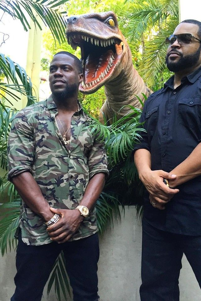 Kevin Hart wearing  Rolex Day-Date Oyster 36mm 18 Carat Watch, Cartier Juste Un Clou Nail Bracelet, Saint Laurent Point-Collar Camouflage-Print Shirt, Balenciaga Multi-Panel High-Top Trainers, Cartier 18 Carat Yellow Gold And Diamond Love Bracelet