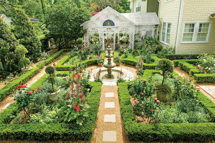 Once a pool,this peaceful English courtyard garden is filled withroses, hollyhocks, and foxgloves.Potted evergreen topiaries lend interest to the parterres when the roses are dormant. It's a slice of British heaven in the Deep South.
