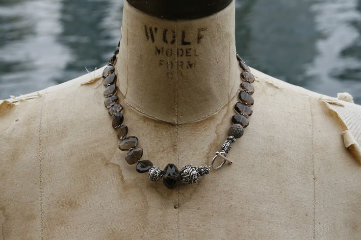 Collar of faceted smokey quartz stones mixed with sterling silver beads.