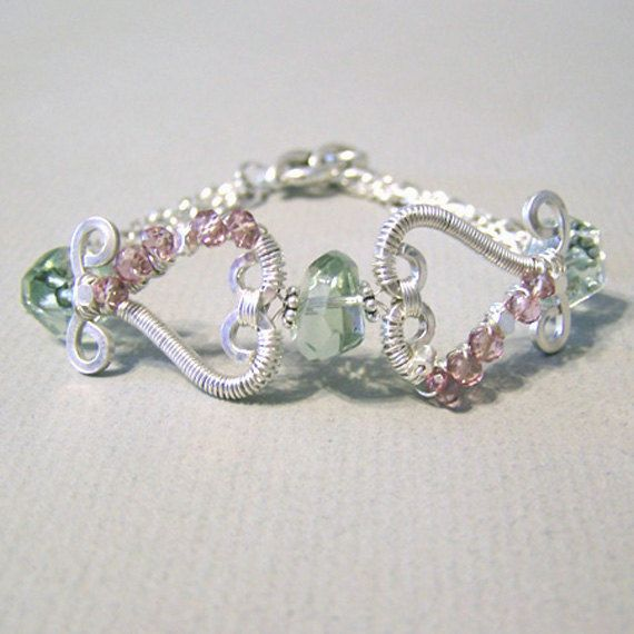 Garden Heart Bracelet Intermediate Tutorial by WireAndMetalJewelry, $6.00. In this tutorial, you will learn how to shape heavy gauge wire into heart frames, then coil the frames while adding beads to the frames. You will also learn how to attach beads in between the two heart frames.