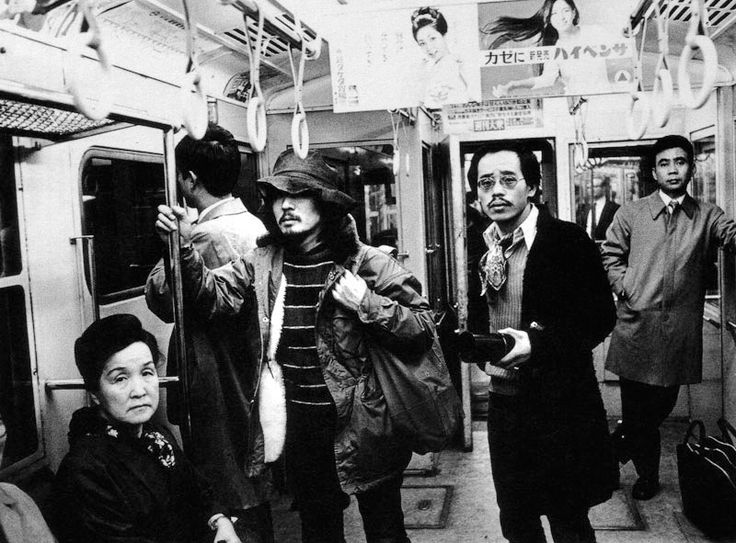 Daido Moriyama and Nobuyoshi Araki on the Tokyo Metro, 1970s.