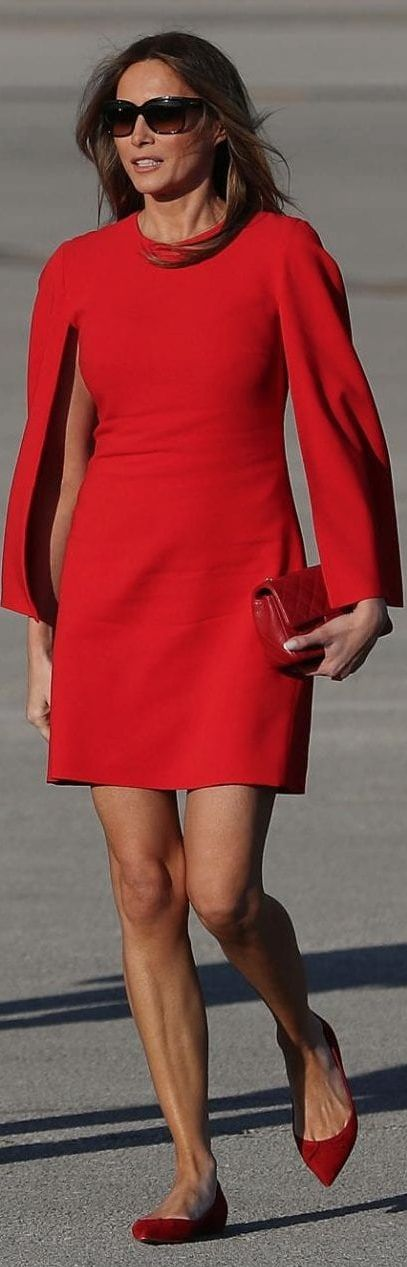 First Lady Melania Trump wearing red Givenchy dress, Chanel bag, and Louboutin flats 2/3/17.