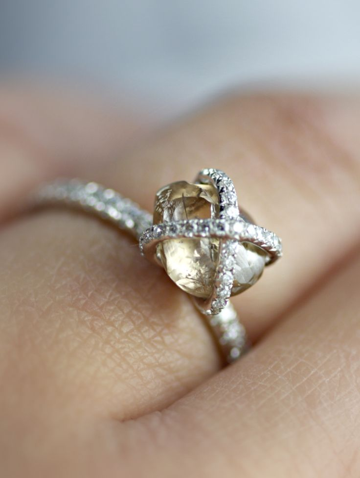 2.28ct Embrace natural rough diamond engagement ring with micro pave diamonds on the band and over the diamond. #unique #rings #jewelry