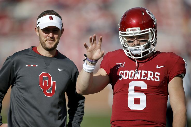 Oklahoma's Baker Mayfield (6) and coach Lincoln Riley talk before a college football game between the Oklahoma Sooners (OU) and the West Virginia Mountaineers at Gaylord Family-Oklahoma Memorial Stadium in Norman, Okla, Saturday, Nov. 25, 2017. Photo by Bryan Terry, The Oklahoman