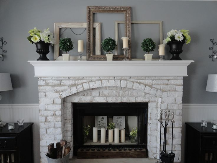 painted brick fireplace water down paint and spongecloth blot