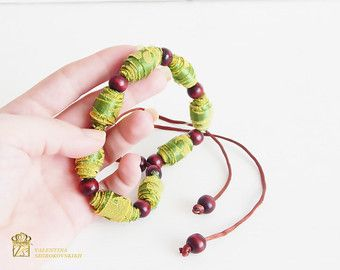 Original handmade jewelry . Achieved decoration denim and metallic yarn . Each bead is made by hand .  Original necklace handmade complement your image. Believe me you will stand out with original decoration. Perfect for any style. It can be worn with T-shirts, sweater or dress.