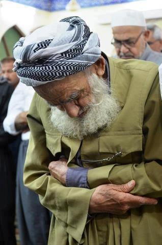 Kurdish Men in in Prayer