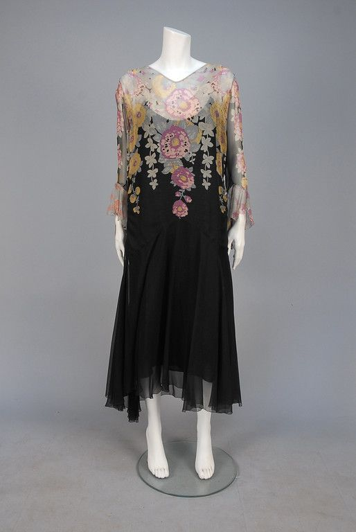 PRINTED CHIFFON DAY DRESS, 1920s. / Black silk with pastel floral print on V-neck bodice and long sleeve with ruffled cuff, side ruching and midriff tucks, dropped waist with full skirt, silk and chiffon under-dress.