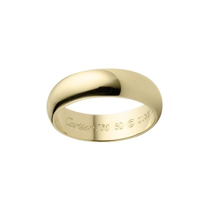 """Brides.com: 35 Men's Wedding Bands He'll Love. Style B4059600, """"Classic Wedding Band"""" in 18k yellow gold, $1,200, Cartier  See more Cartier wedding rings."""
