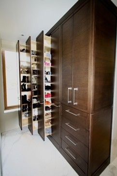 Shoes are arranged on a pullout rack system. Shelves are adjusted per heel height. With 2-3 pairs of shoes per shelf we are told there are o...
