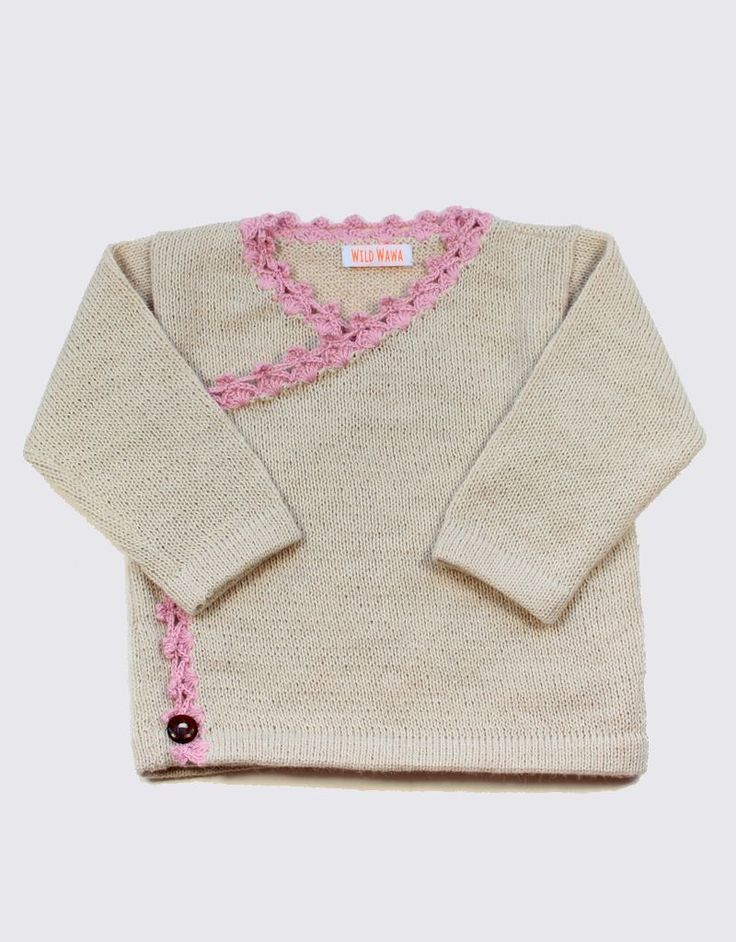 Alpaca crossover cardigan in natural colour soft white, light pink crochet finish and wooden buttons by Wild Wawa