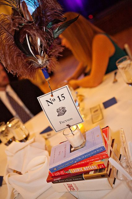 So many favor ideas!  I LOVE this idea.  (Each table is a different genre, and you leave books for guests to take as favors).