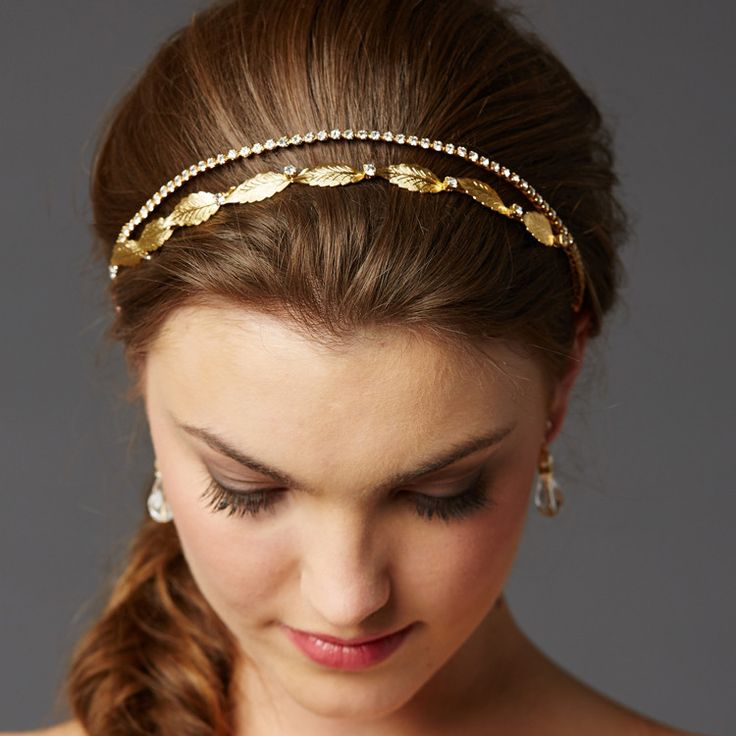 A garland of delicate leaves and Genuine Preciosa crystals are hand-wired to a slender headband for a botanical statement headpiece. Includes ivory ribbons and eyelets to wear as a bridal crown or headband. Hand-crafted.Presented in Roman