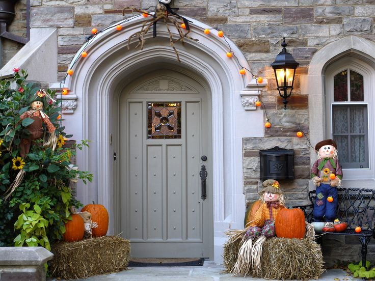 decoration ideas classic wood house entrance with cool halloween pumpkin above straw and cute doll fascinating halloween decoration ideas