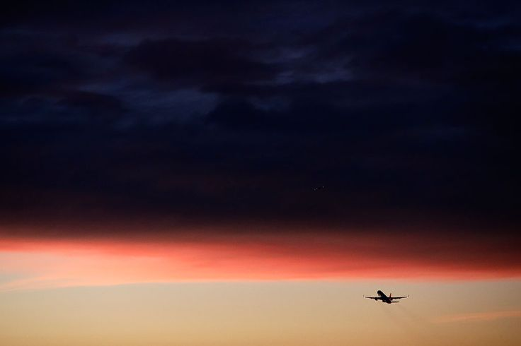 Airplane and dark clouds wallpaper