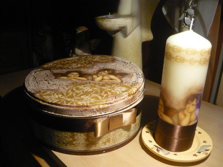 Pudełko na cukierki lub ciasteczka oraz świeczka z motywem aniołków.