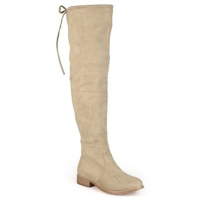 Take on the season in chic style with knee-high boots by Journee Collection. These tall boots feature premium faux suede uppers that rise above the knees and feature a back-tie accent at the top. Wood grain soles and small block heels complete the look.