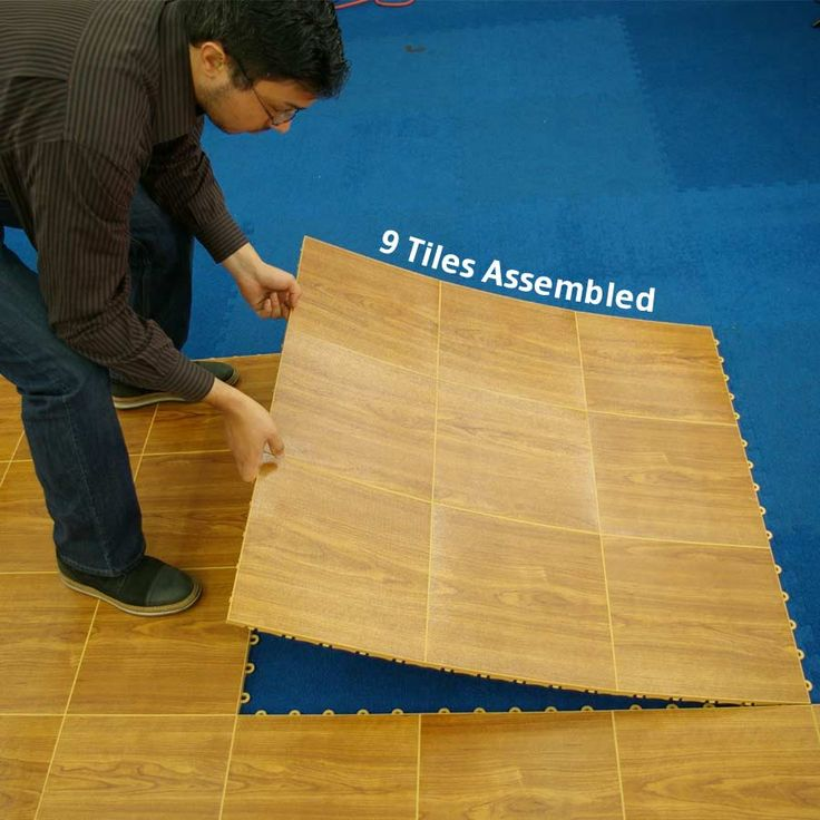 Portable Dance Floor Tile 9 tiles outdoor 3x3.... This site has a lot of portable flooring options. Might not work on uneven ground though