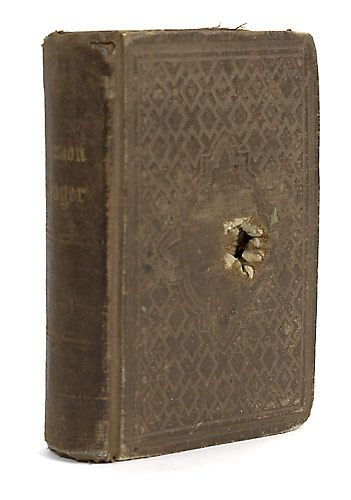 Proof that carrying a Bible with you is a good idea: Civil War Prayer Book which stopped a Bullet at the Battle of Roanoke Island, N. C. and saved the life of Private Edward R. Graton, Co. C, 25th Regt. Mass. while it was tucked inside his uniform coat breast pocket.