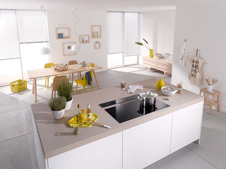 This Miele hob has bevelled glass edges for a contemporary finish. Designed for using on an island, it has a greatly reduced depth, allowing the cooking area to be arranged in a panoramic row, as opposed to the traditional square design   Pictured: Miele KM6381 induction hob