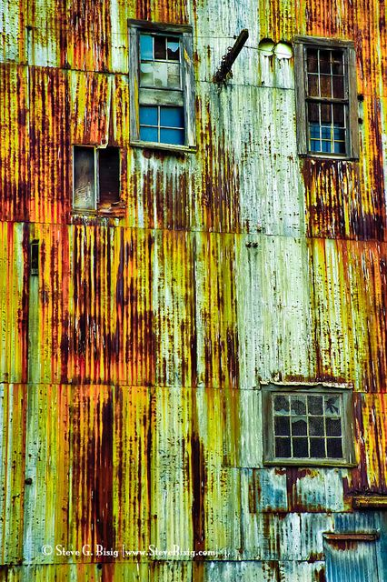 Rusty Metal Building, by Steve G. Bisig via Flickr.