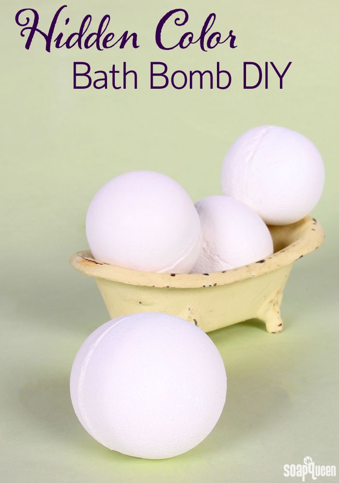These bath bombs look plain white, but once you throw them in the tub they release a hidden color!