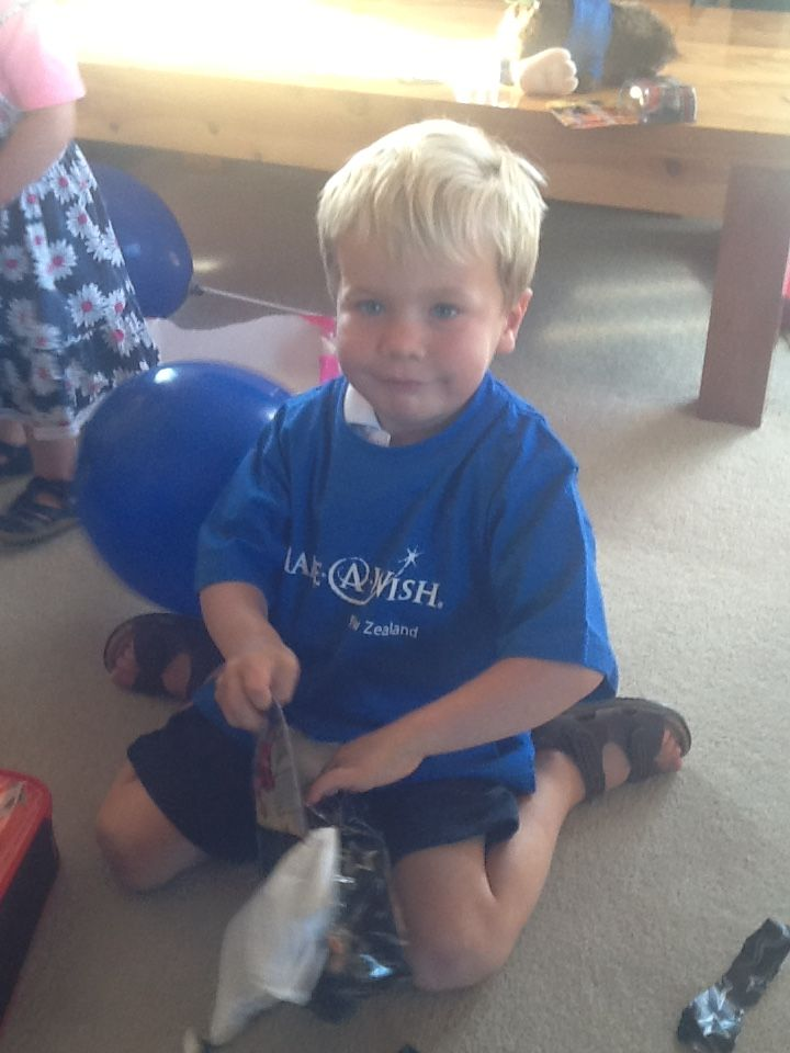 Lars is 4 years old and has Cystic Fibrosis. He loved being the centre of attention when our lovely volunteers arrived with his wish box! Lars couldn't believe all the gifts – ESPECIALLY the John Deere tractors! He has played with them every day since our visit. He also loved his Make-A-Wish t-shirt and has been wearing it to preschool! #MakeAWishNZ