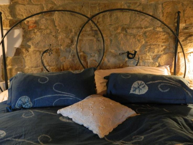 Bed in wrought iron: a traditional Tuscan  handicraft art .