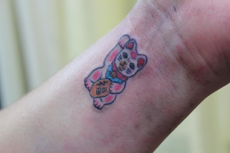 """Maneki Neko- Japanese for """"Lucky Cat"""". This is my newest tattoo and I LOVE LOVE LOVE IT"""