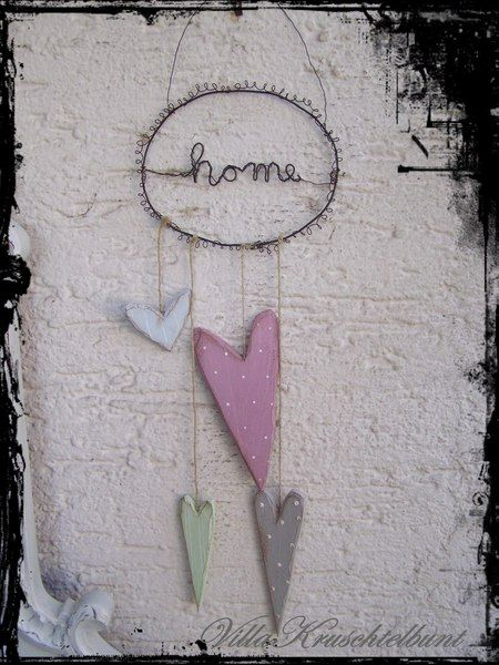 Door hanger wire with a wooden heart