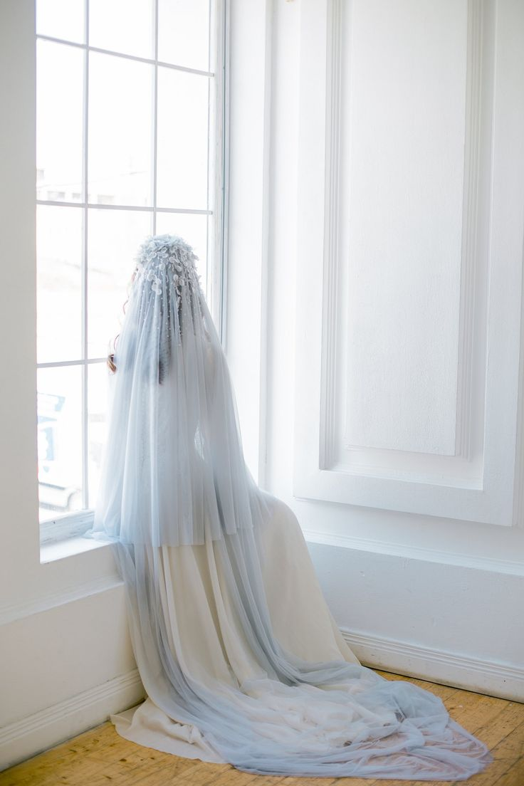 Light blue two tier cathedral veil with hand-sewn textile headpiece and petals with crystals