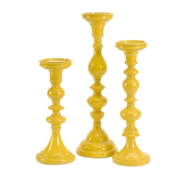 Love love love. Get yours @ kubes furniture. (10319-3) Essential Yellow Candle Holders sold separately