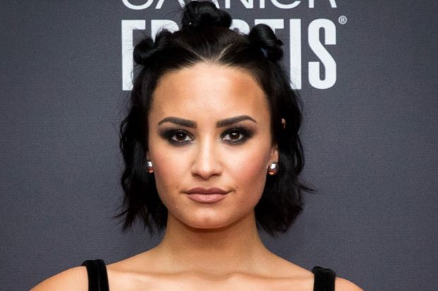 Demi Lovato Sparks Outrage Wearing a Fur Coat While Cuddling Her Dog and More Celebrity News