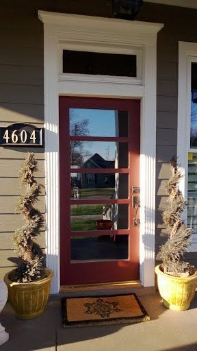 A gorgeous red door with trimmings that will look amazing in your home by ETO Doors