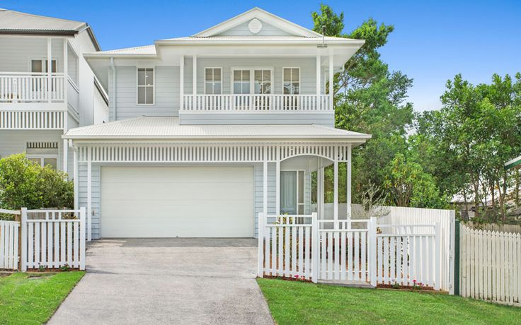 This lightweight 'Hamptons' style home includes space for a family to work, play and entertain.