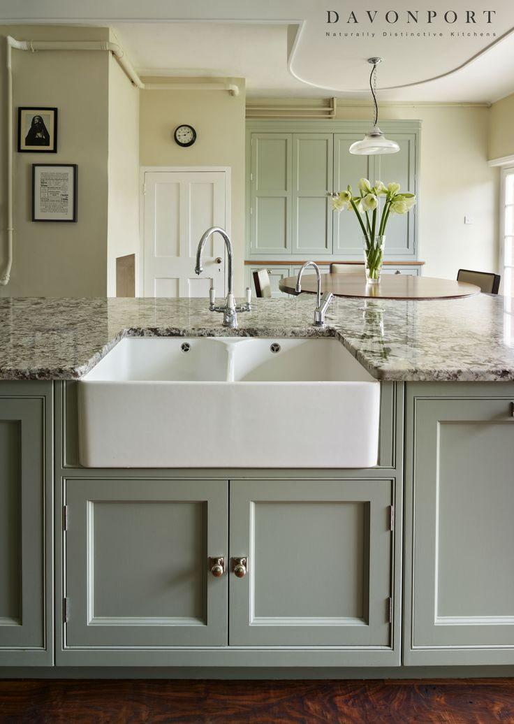 The Butler sink built into the island adds a quintessentially English feature to this classic English kitchen. The Perrin & Rowe mixer tap fits the  traditional atmosphere of the room, while the Quooker boiling water tap provides the modern luxury of instant boiling water.