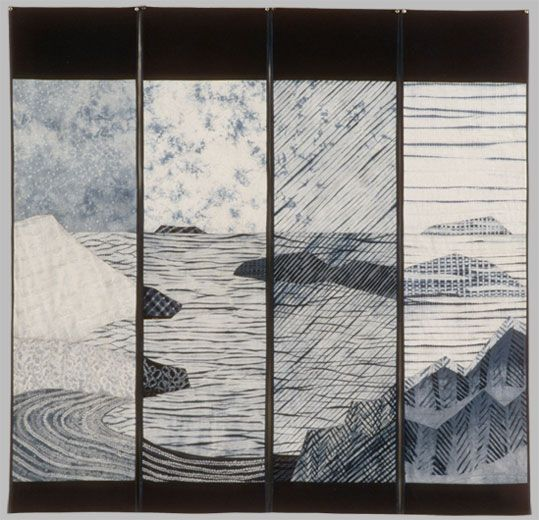 Hand dyed shibori cottons in indigo, pieced and quilted by hand and by machine. This is quite Japanese in style. The four panels are reminiscent of noren, the fabric signs that hang outside shops in Japan. The continuous scene reminds me of landscape imagery on Asian scrolls or screens. The depiction of weather elements were inspired by portraits of snow ,clouds, rain and fog in Japanese prints.
