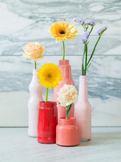 Regular paint in ombre tints inside the vases + plastic tube to hold the flowers