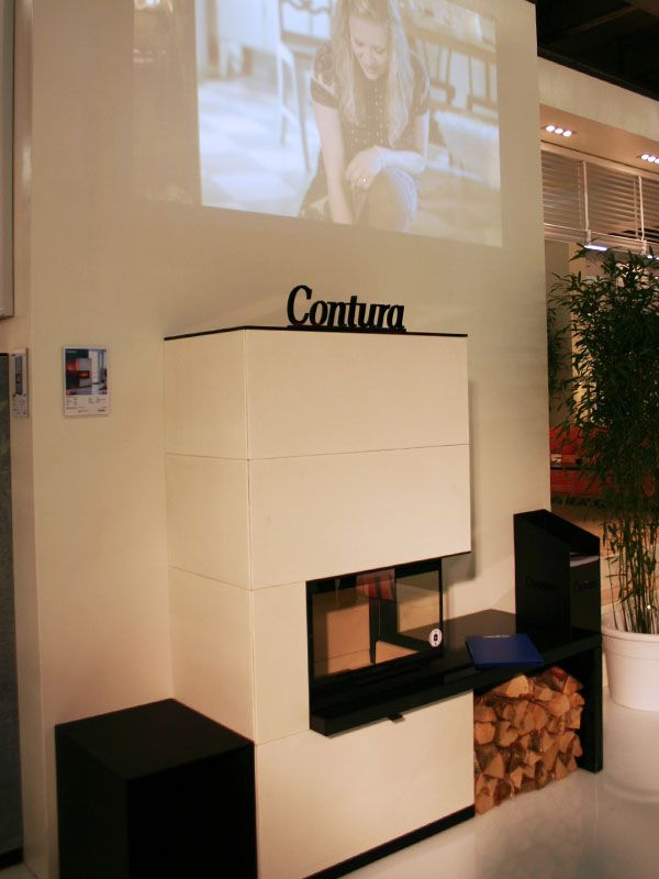Contura at ISH 2015. The masonry fireplace Contura i41A. Exclusive woodburner with surrounding in artstone.
