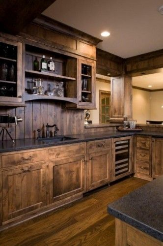 Love the bottom cabinets of this kitchen.  Top is a little dark though, would brighten up with farmhouse sink, different countertops, and a lighter backsplash