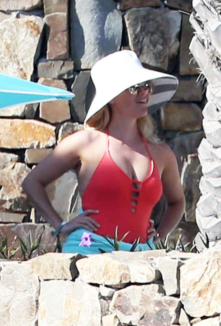 Pin for Later: Reese Witherspoon Wears the Sexy Cutout Swimsuit That's Been Missing From Our Lives  Reese played up her cutout monokini with a white sunhat.
