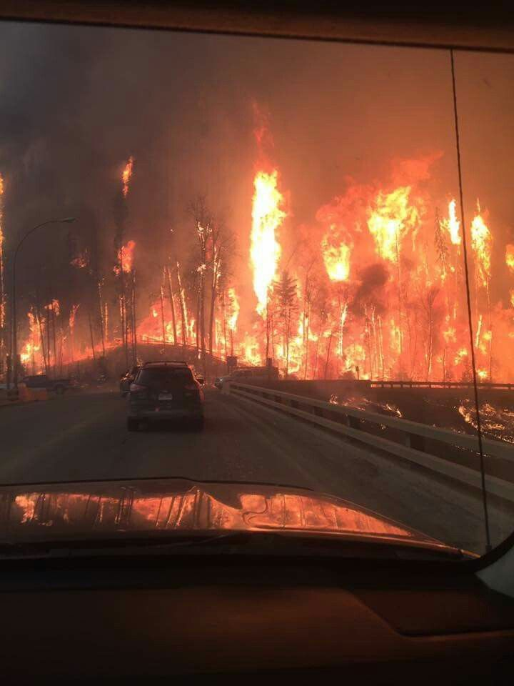 The wall of fire on both sides of highway 63, the only highway that goes out city of Fort McMurray, 8,800 people evacuated on first day