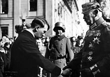 Hitler Becoming chancellor of Germany gave the people hope of being victorious because of his actions he took that were different than ww2. The picture shows Adolf Hitler on the day of potsdam. This source is reliable due to the fact it is from wikipedia.
