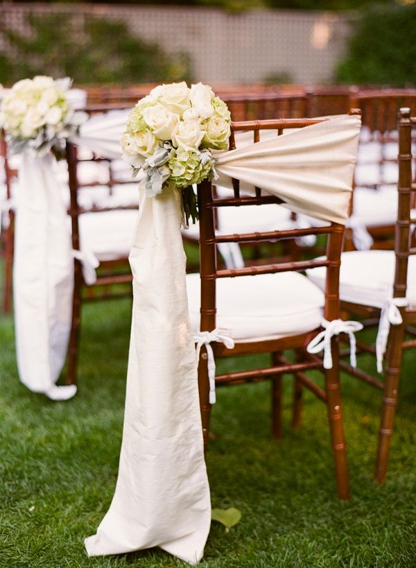 Tulle Wrap on end chair with small green and yellow bouquet.   Could be Silk Wrap on Ceremony Chairs With Rose and Hydrangea Bouquet #wedding ideas