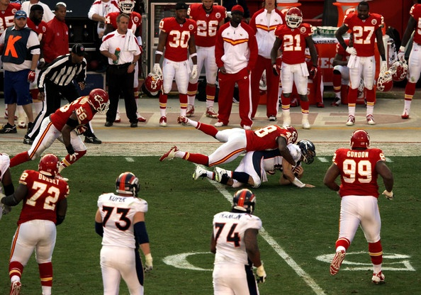 Get off him! Tim Tebow tackled during Chiefs game
