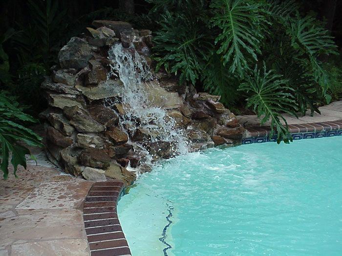 Pool Waterfalls | Rock Waterfall Moss Rock Waterfall Tiled Waterfeature  With Travertine ... Rock WaterfallPool IdeasSwimming ...